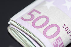 A stack of euro banknotes with a rubber band stock image