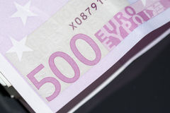 A stack of euro banknotes with a rubber band stock photo
