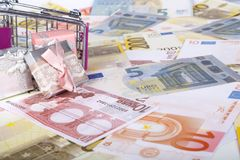 Euro Banknotes with Shopping Cart and Gift Boxes Consuming Conce Royalty Free Stock Images