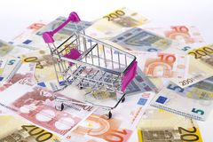 Euro Banknotes with Shopping Cart Consuming Concept Stock Image