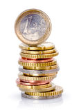 Stack of Euro coins. A pile or stack of varying denominations of Euro coins. White background royalty free stock photo