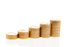 Stack of Euro coins. Some piles of coins on white background Royalty Free Stock Images