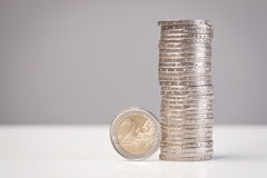 Stack of Euro coins. A stack of 2 Euro coins with a single coin standing next to it stock images