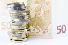 Stack of Euro Coins and banknote Stock Photos