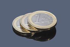 Stack of euro coins on gray background Stock Photos