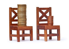 Stack of euro coins on wooden chairs Stock Photo
