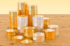 Stack of Euro coins on the wooden table. 3D rendering. Stack of Euro coins on the wooden table. 3D Stock Image