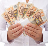 Stack of euros in woman hands Royalty Free Stock Photography