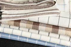 Stack of fabric napkins on black table royalty free stock images