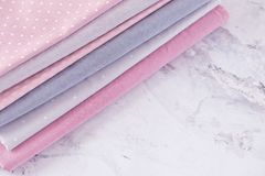 Stack of fabrics over marble table Royalty Free Stock Photo