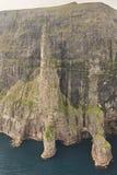 Stack in Faroe islands, Sandavagur. Trollkonufingur in Vagar island