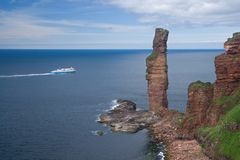 Stack and ferry. The Old Man of Hoy and a car ferry, Orkney stock images