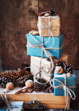 Stack of Festive Boxes with Cords, Natural Gifts. Vintage style Royalty Free Stock Photos