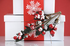 Stack of festive red and white theme Christmas gift boxes - closeup. Royalty Free Stock Photo