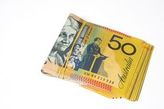 Stack of fifty Australian dollar bills on white background. Royalty Free Stock Photography