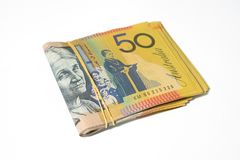 Stack of fifty Australian dollar bills on white background. Royalty Free Stock Photos