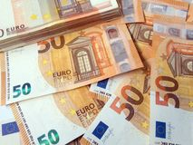 Stack of fifty euro banknotes and banknotes spread wage profit concept. Photo Royalty Free Stock Image