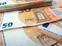 Stack of fifty euro banknotes and banknotes spread wage profit concept. Photo Royalty Free Stock Photo