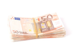 Stack of fifty euro notes with rubber band. Stack of fifty euro notes wit a rubber band, isolated on white Stock Images