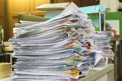 Stack of files full of documents signifying Stock Images