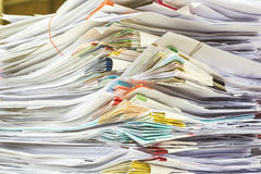 Stack of files full of documents signifying Stock Image