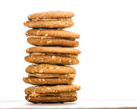 Stack of filled peanut butter cookies on white Stock Image