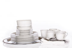 Stack of fine dishes on silver tray Stock Images