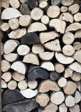 Stack of fire wood background. A pile of sawn logs and wood in a wood store for an environmental background Stock Photography