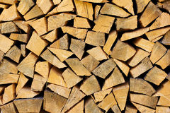 Stack of firewood  as a wooden background Stock Photos