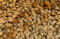 Stack of firewood. Background of dry chopped firewood logs stacked up on top of each other in a pile Stock Photo