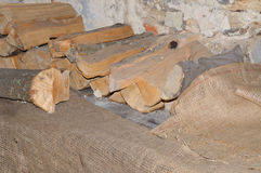 Stack of firewood. Dried firewood for the bonfire on sacking Stock Photos