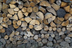 Stack of firewood. Dry stack of cut wood prepared for fire stock images