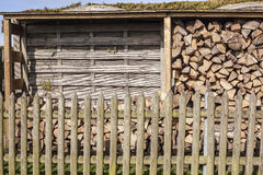 Stack of firewood at the half-filled on a sunny day Stock Images