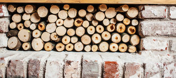 Stack of firewood. Indoors, near the fireplace Stock Photo