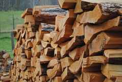 Stack of firewood larch Royalty Free Stock Photos
