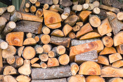 Stack of firewood logs. Close up of stack of cut firewood logs Stock Photo