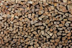 Stacked split firewood logs background stock photos