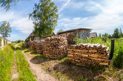 Stack of firewood stacked near the rural house stock photography