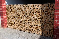 Stack of firewood stored outside stock photography
