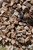 Stack of firing wood. Wood logs cut for firing and stacked in a big pile Royalty Free Stock Images