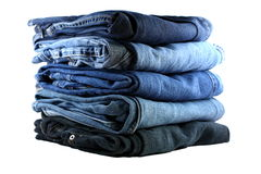 Stack of five blue jeans. Stack of five various shades of blue jeans on a white background Royalty Free Stock Images
