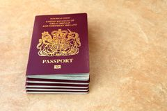 Stack of five British United Kingdom European Union Biometric pa. Ssports with copyspace for text Stock Photos