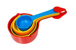 Stack of five ingredient measuring spoon in set with red clip fo Stock Image
