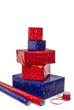 Stack of five Presents and wrapping Paper Stock Image