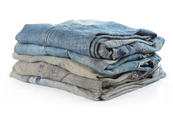 Stack of five various shades of blue jeans Stock Photography