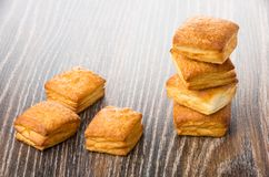 Stack of flaky biscuits on dark table Stock Images