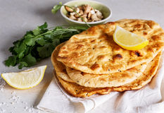 Stack of flat bread and herbs on a table Stock Photography
