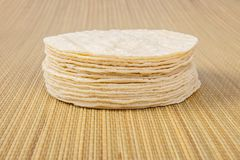 Stack Of Flour Tortillas. A stack of flour tortillas on a bamboo background stock images