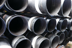 Stack of flush joint connection oil well casing. (pin end) bundles Royalty Free Stock Photography