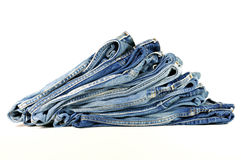 Stack of folded blue jeans Royalty Free Stock Photos